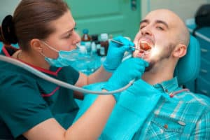 man receiving dental cleaning