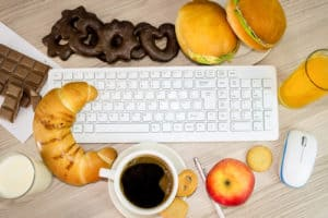 workspace covered with snacks