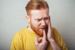 man with dental pain